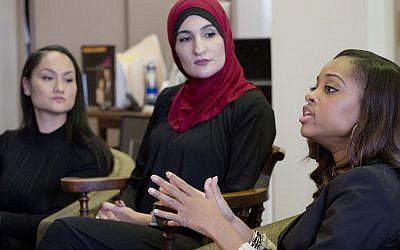 Tamika Mallory, right, co-chair of the Women's March on Washington, DC, talks during an interview with fellow co-chairs Carmen Perez, left, and Linda Sarsour, January 9, 2017, in New York City. (AP Photo/Mark Lennihan)