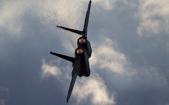 This Thursday, December 29, 2016 photo shows an Israeli Air Force F-15 plane in flight during a graduation ceremony for new pilots in the Hatzerim air force base near the city of Beersheba, Israel. (AP/Ariel Schalit)