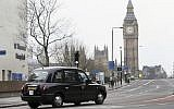 Illustrative: A black cab drives past London's Westminster Bridge, March 23, 2017 (AP Photo/Tim Ireland)