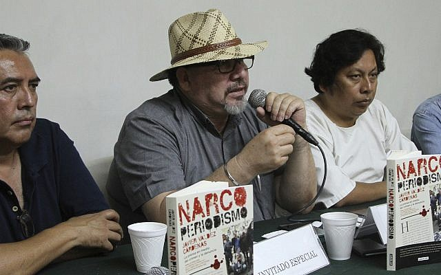 In this picture taken March 22, 2017, journalist Javier Valdez speaks during the presentation of his latest book, in Acapulco, Mexico. (AP Photo/Bernandino Hernandez)