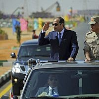 In this photo provided by Egypt's state news agency, MENA, Egyptian President Abdel-Fattah el-Sissi salutes as he inspects troops with Defense Minister Sedki Sobh at the Red Sea port city of Suez, Egypt, on October 29, 2017. (MENA via AP)