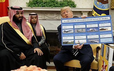 President Donald Trump shows a chart highlighting arms sales to Saudi Arabia during a meeting with Saudi Crown Prince Mohammed bin Salman in the Oval Office of the White House, Tuesday, March 20, 2018, in Washington. (AP/Evan Vucci)