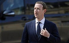 """Facebook's CEO Mark Zuckerberg arrives to meet France's President Emmanuel Macron after the """"Tech for Good"""" Summit at the Elysee Palace in Paris on May 23, 2018. (AP Photo/Francois Mori)"""
