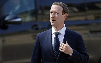 "Facebook's CEO Mark Zuckerberg arrives to meet France's President Emmanuel Macron after the ""Tech for Good"" Summit at the Elysee Palace in Paris on May 23, 2018. (AP Photo/Francois Mori)"