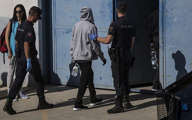 Illustrative: Migrants are led into the Migrants Reception Center near Algerciras, Spain, Thursday, August 9, 2018. (AP/Javier Fergo)