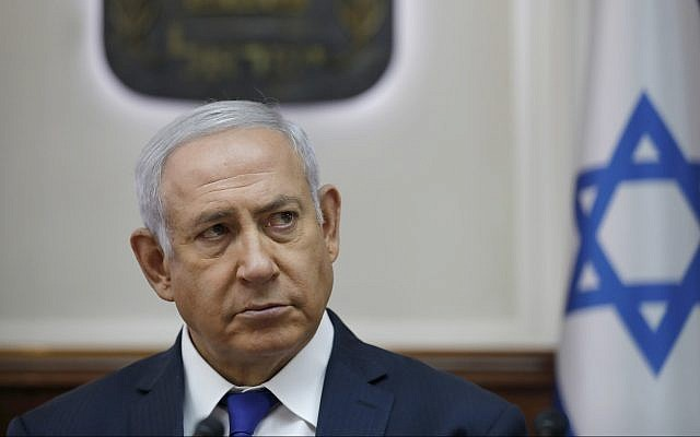 In this October 7, 2018 file photo, Prime Minister Benjamin Netanyahu attends the weekly cabinet meeting at his office in Jerusalem. (Abir Sultan/Pool via AP, File)