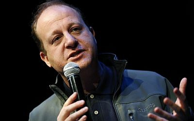 Jared Polis, Democratic candidate for Colorado's governorship, speaks during the first stop of a statewide bus tour to drum up support among Democrats Friday, Oct. 26, 2018, in Silverthorne, Colo. (AP Photo/David Zalubowski)