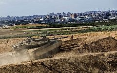 An Israeli tank takes a position at the Gaza Strip border, October 27, 2018.  (AP/Tsafrir Abayov)