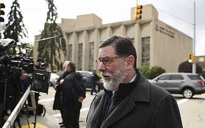 In this Sunday, Oct. 28, 2018 photo, Pittsburgh Mayor Bill Peduto walks in view of the Tree of Life Synagogue in Pittsburgh. (AP Photo/Matt Rourke)