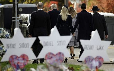 US President Donald Trump, first lady Melania Trump, Ivanka Trump and Jared Kushner leave a memorial outside Pittsburgh's Tree of Life Synagogue in Pittsburgh, Tuesday, Oct. 30, 2018. (AP Photo/Matt Rourke)