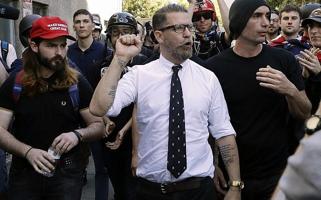 FILE - In this April 27, 2017 file photo, Gavin McInnes, center, founder of the far-right group Proud Boys, is surrounded by supporters after speaking at a rally in Berkeley, California (AP Photo/Marcio Jose Sanchez, File)