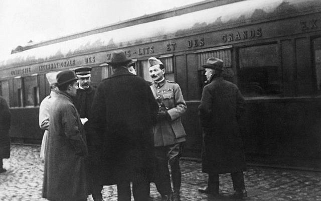 In this file photo from Nov. 1918, the German and French delegations speak as they wait in Rethondes for the start of the train to the Armistice conference in the Forest of Compiegne, France (AP Photo, File)