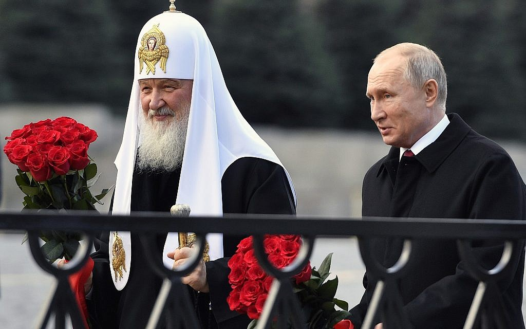 Russian President Vladimir Putin and Russian Orthodox Church Patriarch Kirill, left, walk to lay flowers at the monument of Minin and Pozharsky at Red Square in Moscow, during National Unity Day in Moscow, Russia, Sunday, November 4, 2018. (Alexander Nemenov/Pool/AP)