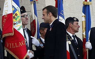 French President Emmanuel Macron greets French veterans during ceremonies marking the centenary of World War I at the cemetery by the Ossuary of Douaumont near Verdun, northeastern France, November 6, 2018. (Francois Mori/AP)