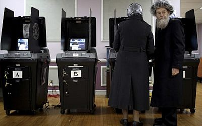 An elderly Orthodox Jewish couple cast their votes at a local polling center on Tuesday, Nov. 6, 2018, in Brooklyn borough of New York. (AP Photo/Wong Maye-E)