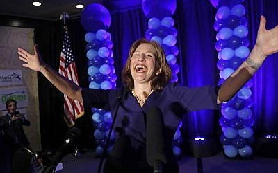 Congressional candidate Kim Schrier addresses the crowd at an election night party for Democrats Tuesday, Nov. 6, 2018, in Bellevue, Wash. (AP Photo/Elaine Thompson)