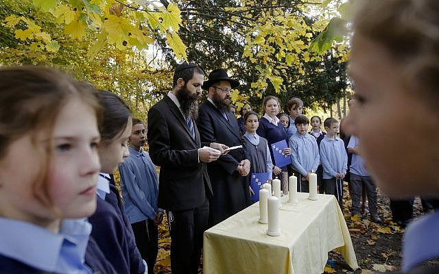 Rabbi Yehuda Teichtal, center right, and Rabbi David Gewirtz, center left, pray during an event to commemorate the victims of the Nov. 9, 1938 terror against the Jews in Germany at the Jewish Traditional School in Berlin, Wednesday, Nov. 7, 2018. (AP/Markus Schreiber)