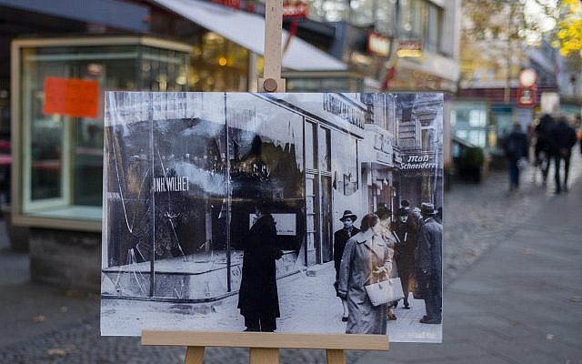 A November 10, 1938 photo from the AP Archive, showing Nazis destroyed Jewish shops at the Kurfuerstendamm street, is placed at the same location 80 years later in Berlin, Germany, Tuesday, Nov. 6, 2018. (Markus Schreiber/AP)