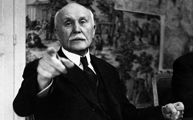 This photo from June 9, 1941, shows France's Marshal Philippe Petain pointing as he ordered our photographer from the room during the sell-out meeting of the Council of Ministers in Vichy, central France. (AP Photo, File)