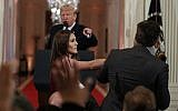 President Donald Trump watches as a White House aide takes away a microphone from CNN journalist Jim Acosta during a news conference in the East Room of the White House, Wednesday, November 7, 2018, in Washington. (AP/Evan Vucci)
