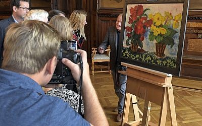 Illustrative photo of a press presentation on the occasion of the restitution of the 1929 painting 'Begonias' by Emil Nolde in Erfurt, Germany, November 12, 2018. (AP/Jens Meyer)