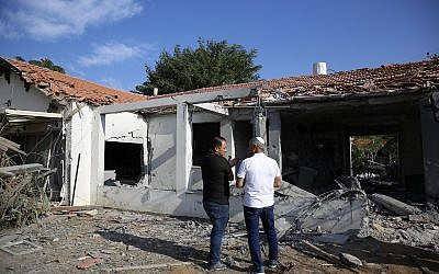 Officials assess the damage to a house after it was hit by a rocket fired by Palestinian terrorists from the Gaza Strip, in the southern Israeli city of Ashkelon, Israel, November 13, 2018. (AP Photo/Ariel Schalit)