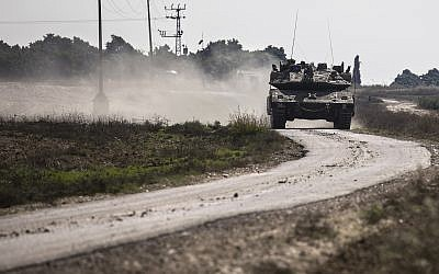 An Israeli tank drives near the Israel Gaza border, Tuesday, Nov. 13, 2018. (AP/Tsafrir Abayov)