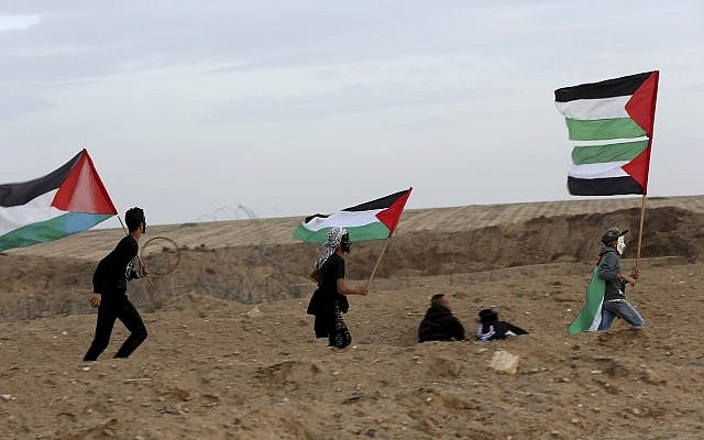 Protesters gather near the fence of the Gaza Strip border with Israel during a protest east of Gaza City, November 16, 2018. (AP/Adel Hana)