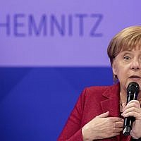 German Chancellor Angela Merkel attends a discussion with citizen at the East German city Chemnitz, Friday, Nov. 16, 2018. (AP Photo/Kay Nietfeld, Pool)