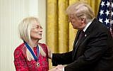 President Donald Trump awards Miriam Adelson, the wife of Las Vegas Sands Corporation Chief Executive Sheldon Adelson and Republican mega donor the Medal of Freedom during a ceremony in the East Room of the White House in Washington, Friday, Nov. 16, 2018. (AP Photo/Andrew Harnik)