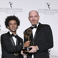 Actor Yossi Vasa, left and director Shai Ben Atar pose in the press room with their award for best comedy, 'Nevsu,' during the 46th International Emmy Awards gala in New York City, November 19, 2018. (Amy Sussman/ Invision/ AP)