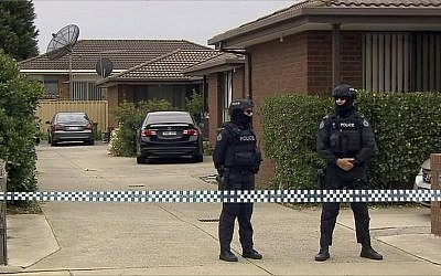 Illustrative: In this image made from video, police stand guard outside a raided property connected to a foiled terror attack, Tuesday, Nov. 20, 2018, in Melbourne, Australia. Three men inspired by the Islamic State group were charged with planning a mass-casualty attack in Australia's second-largest city Melbourne. (ABC via AP)