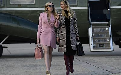 Ivanka Trump and Tiffany Trump walk from Marine One Helicopter to Air Force One at Andrews Air Force Base in Md., Tuesday, Nov. 20, 2018. They are joining President Donald Trump for a trip to Florida for a week at Mar-a-Lago for Thanksgiving. (AP Photo/Susan Walsh)