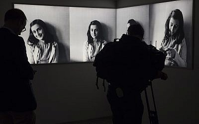 Journalists take images of the renovated Anne Frank House Museum in Amsterdam, Netherlands, Nov. 21, 2018 (AP Photo/Peter Dejong)