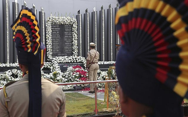 Indian police officers pay tribute to the victims of the Mumbai terror attacks at a memorial in Mumbai, India on Nov. 26, 2018. (AP Photo/Rafiq Maqbool)