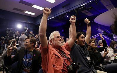 People at NASA's Jet Propulsion Laboratory in Pasadena, California, celebrate as the InSight lander touches down on Mars on November 26, 2018. (AP Photo/Marcio Jose Sanchez)