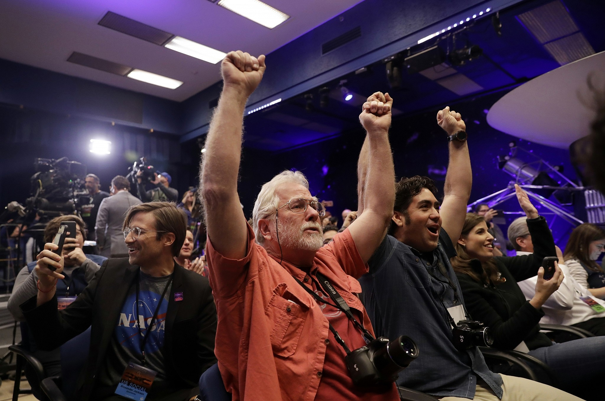 People at NASA's Jet Propulsion Laboratory in Pasadena California celebrate as the In Sight lander touches down on Mars
