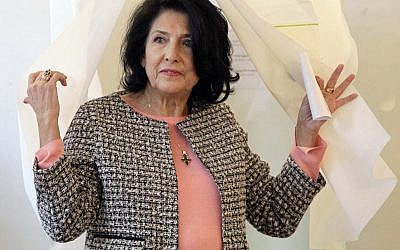 Salome Zurabishvili, former Georgian Foreign minister and presidential candidate, exits a polling booth as she prepares to cast her ballot during the presidential election at the polling station in Tbilisi, Georgia, on November 28, 2018. (AP Photo/Shakh Aivazov)
