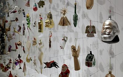 Christmas tree decorations are displayed at the German Historic Museum in Berlin, Germany, Friday, Nov. 30, 2018 during the exhibition 'Angel, Swastika, Dome of the Rock. Christmas Tree Decorations from the 19th Century until Today'. (AP Photo/Michael Sohn)