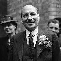 Clemet Attlee smiles at the cheering throngs which gathered at Transport House, in London on July 26, 1945, to hear Labour's great victory at the polls. Violet Attlee stands beside her husband,left. (AP Photo)