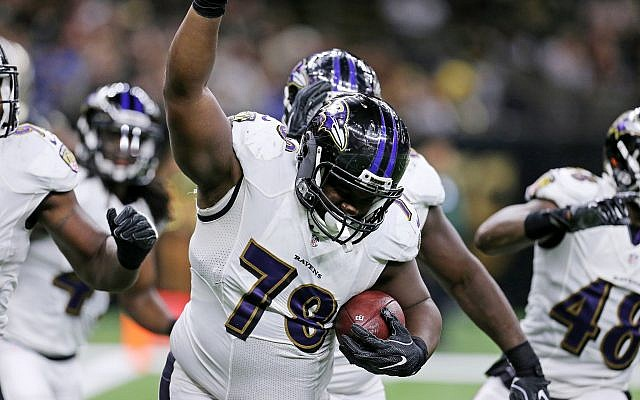 Baltimore Ravens defensive tackle Michael Pierce (78) celebrates after recovering a fumble in the end zone by New Orleans Saints quarterback Drew Brees for a touchdown in the first half of a pre-season NFL football game in New Orleans, September 1, 2016. (AP/Butch Dill)