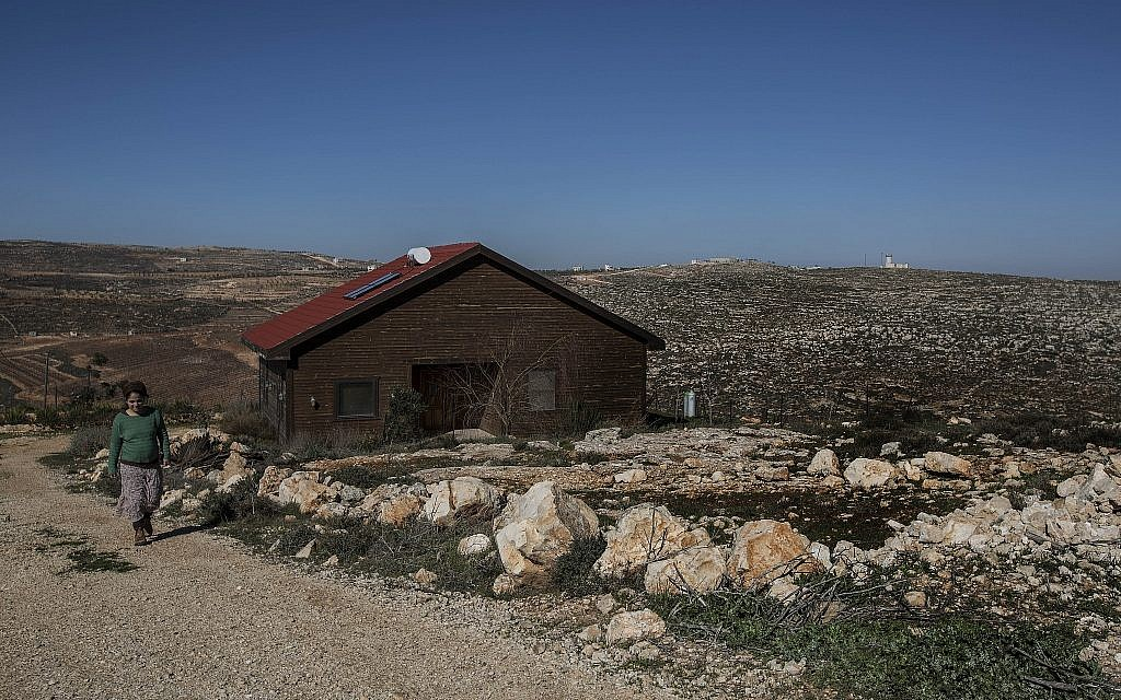 Inbal Zeev walks, on January 17, 2016, by her guest house advertised on Airbnb in the Nofei Prat settlement in the West Bank. (AP/Tsafrir Abayov)