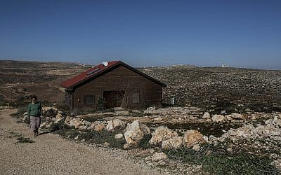 Inbal Zeev walks, on January 17, 2016, by her guest house advertised on Airbnb in the Nofei Prat settlement in the West Bank. (AP/Tsafrir Abayov)