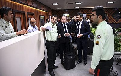 Iranian police officers check the passports of passengers of an Air France flight at Tehran's Imam Khomeini International Airport some 25 miles (40 kilometers) south of the capital Tehran, Iran, Sunday, April 17, 2016. (AP Photo/Vahid Salemi)