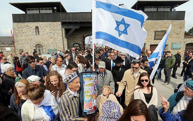 Members of a delegation from Israel arrive for a ceremony to commemorate the 70th anniversary of the liberation of the Nazi concentration camp in Mauthausen, Austria, Sunday, May 10, 2015. (AP Photo/Ronald Zak)