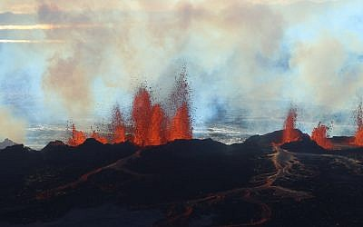 In this aerial view, fountains of lava, up to 60 meters high, spurt from a fissure in the ground on the north side of the Bardarbunga volcano in Iceland, Tuesday, September 2, 2014. (AP Photo/Stefano Di Nicolo)
