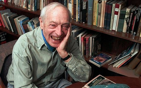 Author Saul Bellow laughs during an interview in his office on April 17, 1997 at Boston University, where he teaches literature (AP Photo/Elise Amendola).
