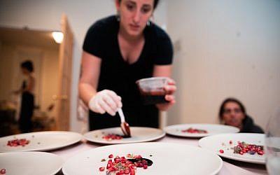 Adina Halpern plates a leg of lamb in pomegranate sauce. (Hanoch Melamed Cohen)