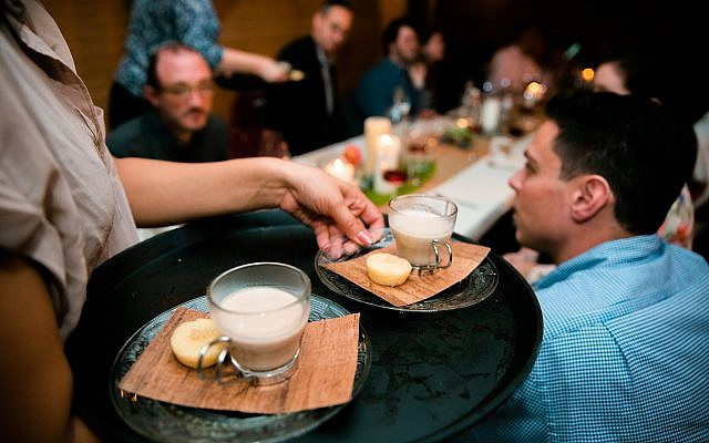 Danielle Brody serves dessert to Musket Club guests: coconut mochi, dates, and coconut milk with coffee liqueur. (Hanoch Melamed Cohen)