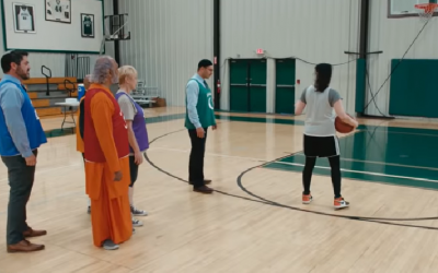 Comedian Sarah Silverman plays basketball with a priest, a rabbi, an imam, a swami and a Buddhist minister to see which religion is the greatest (Screenshot/YouTube)